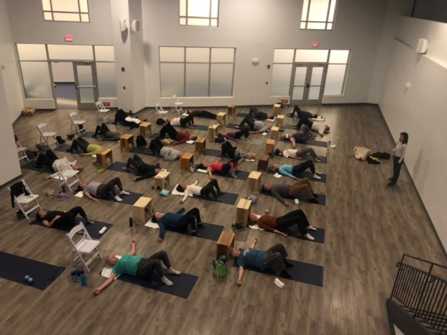 Miracle Ball Method Training and Instructor Discount. Group of students on floor during a training session.